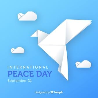 Jour de la paix en origami avec colombe