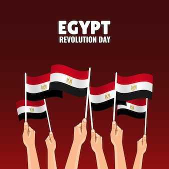 Jour de la révolution en égypte. les mains tiennent les drapeaux du pays