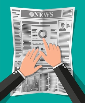 Journal quotidien en mains