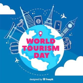 Journée du tourisme dessiné à la main attractions touristiques et accessoires
