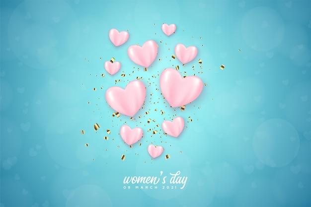 Journée de la femme avec des ballons d'amour roses sur fond bleu.