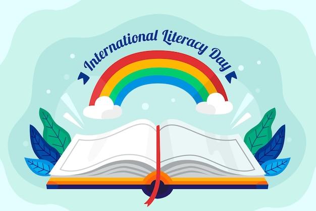 Journée internationale de l'alphabétisation avec livre ouvert et arc-en-ciel
