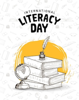 Journée internationale de l'alphabétisation avec des livres d'encre de stylo plume et un pinceau jaune globe sur fond blanc