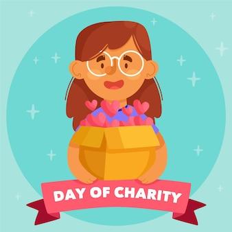 Journée internationale de la charité avec femme tenant une boîte de coeurs