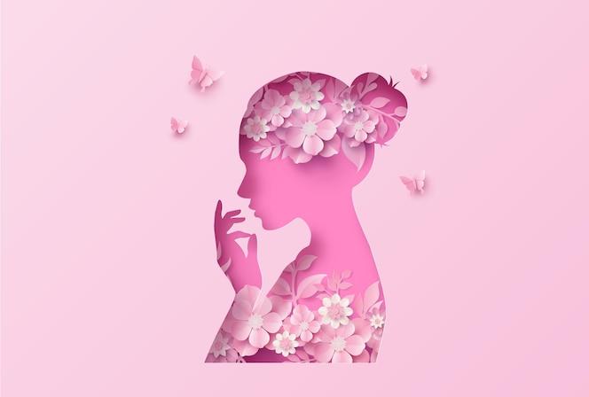 Journée internationale de la femme 8 mars avec cadre de fleurs et de feuilles, style art papier.