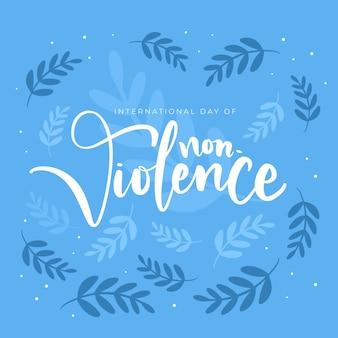 Journée internationale mignonne de lettrage de non-violence avec des feuilles