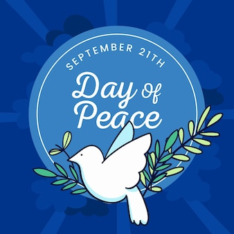 Journée internationale de la paix avec colombe et feuilles