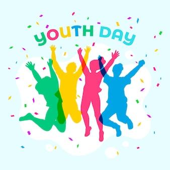 Journée de la jeunesse sautant des silhouettes de personnes