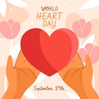 Journée mondiale du cœur dessiné à la main avec les mains