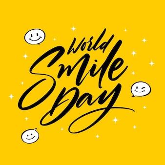 Journée mondiale du sourire avec lettrage de visage heureux