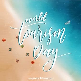 Journée mondiale du tourisme avec plage floue