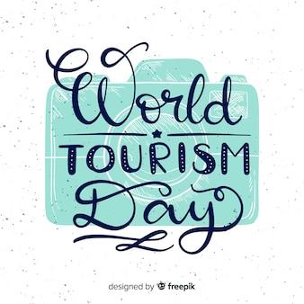 Journée mondiale du tourisme avec typograhy