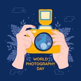 Journée mondiale de la photographie avec appareil photo et mains