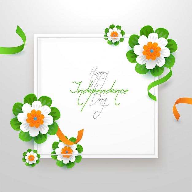 Joyeuse calligraphie de la fête de l'indépendance avec des fleurs coupées en papier tricolore indien et ruban décoré sur fond blanc.