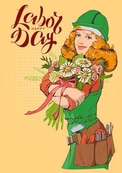 Joyeuse fête du travail. travailleuse en casque avec bouquet de fleurs
