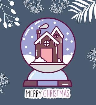 Joyeuse fête de noël en pain d'épice maison dans la neige boule de cristal