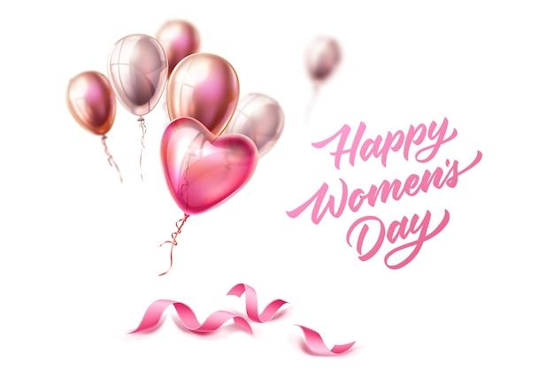 Joyeuse journée de la femme lettrage sur des rubans de soie élégants avec des ballons coeur pour la journée internationale des femmes, le 8 mars. carte de voeux de vacances, décoration de bannière d'invitation