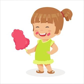 Joyeuse petite fille mangeant des bonbons de sucre
