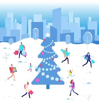 Joyeuses fêtes de noël. gens d'hiver marchant à l'arbre de noël de la ville. famille en vacances d'hiver