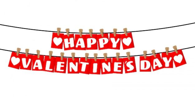 Joyeuses fêtes de saint valentin sur les balises rouges suspendues.