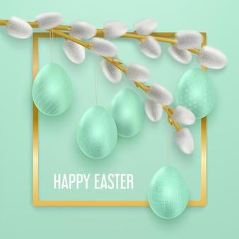Joyeuses pâques avec des branches de saule de printemps avec des oeufs de pâques accrochés dessus