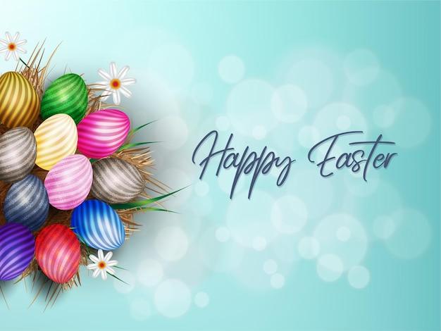 Joyeuses pâques .eggs dans l'herbe sèche avec des fleurs blanches isolées