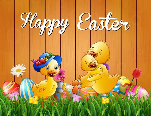 Joyeuses pâques famille canard sur l'herbe
