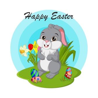 Joyeuses pâques. lapin de pâques mignon avec des oeufs dans l'herbe