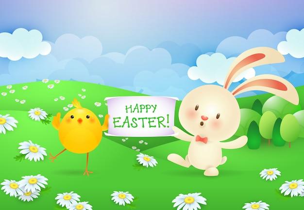 Joyeuses pâques, lettrage sur la bannière tenue par le lapin et le poussin