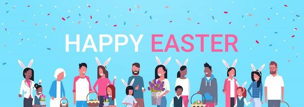 Joyeuses pâques, lettrage, groupe, gens, famille, célébrer, printemps, vacances, porter, oreilles de lapin, bannière horizontale