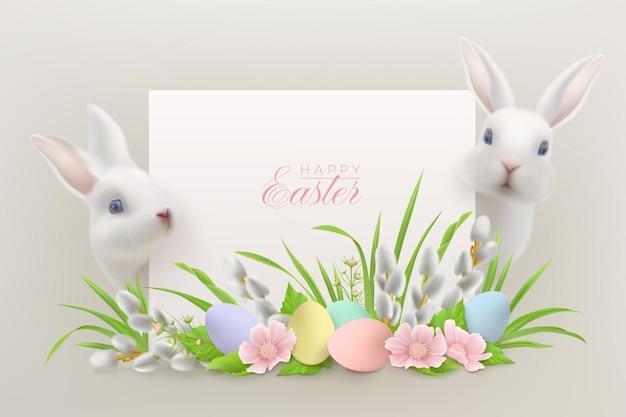 Joyeuses pâques avec des lièvres blancs réalistes assis derrière une carte de voeux et un arrangement floral avec des oeufs de pâques et des branches de saule