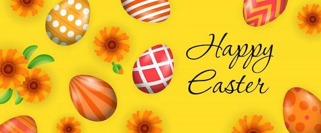 Joyeuses pâques avec des oeufs décorés et des fleurs