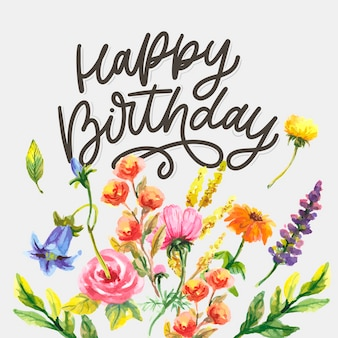 Joyeux anniversaire lettrage slogan de calligraphie avec des fleurs