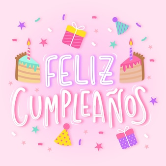 Joyeux anniversaire en lettres espagnoles avec gâteau
