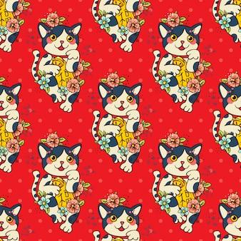 Joyeux chat japonais maneki-neko fleuri.