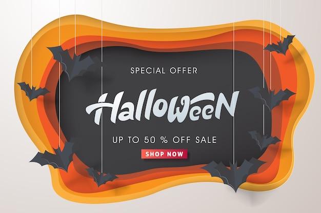 Joyeux halloween calligraphie avec des chauves-souris en papier volant.
