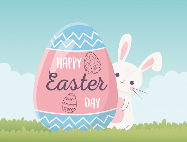 Joyeux lapin mignon de pâques et oeuf avec décoration de lettrage, carte de voeux