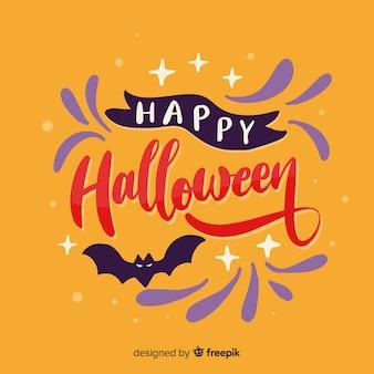 Joyeux lettrage d'halloween et bat