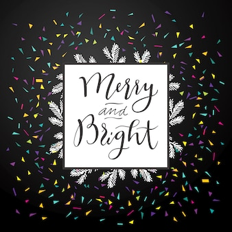 Joyeux et lumineux. carte de voeux artistique joyeux noël calligraphie avec des confettis