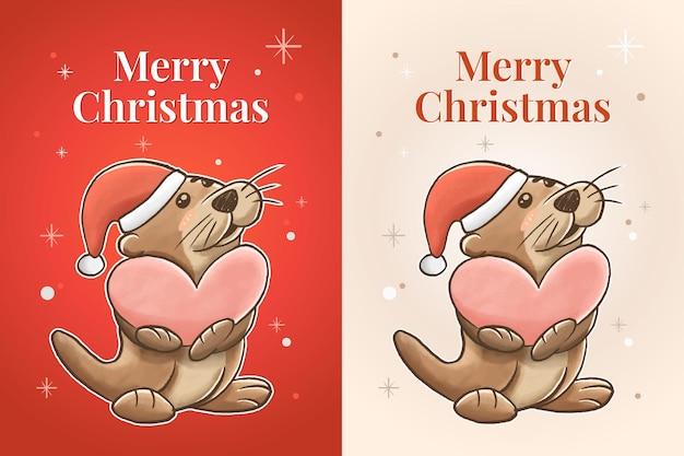 Joyeux noël avec l'animal mignon de loutre tenant un cadeau de coeur