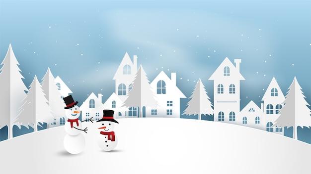 Joyeux noël avec bonhomme de neige en papier en hiver.