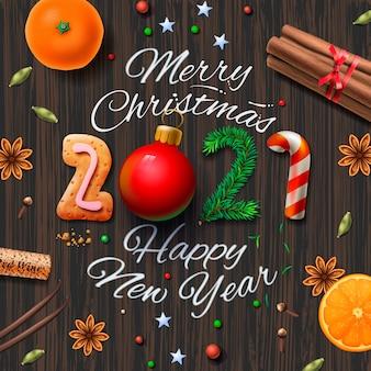 Joyeux noël, bonne année 2021, fond vintage avec typographie et épices pour boire du vin chaud de noël