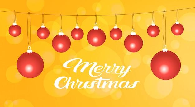 Joyeux noël bonne année balles rouges décoration carte de voeux