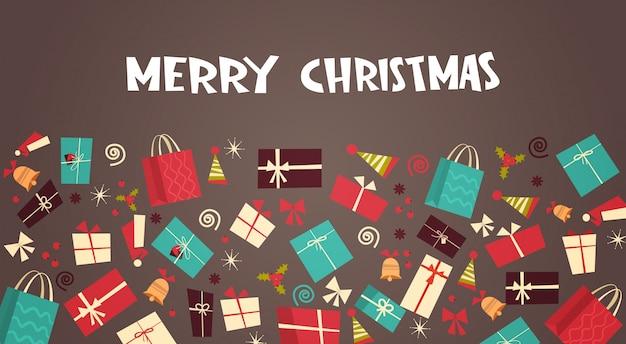 Joyeux noël et bonne année carte de voeux avec différents coffrets cadeaux hiver présente un concept