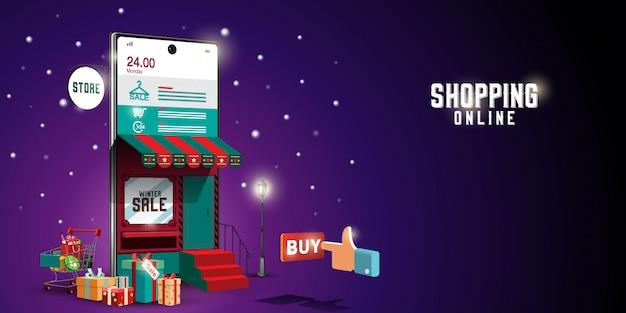 Joyeux noël et bonne année du shopping en ligne dans la nuit d'hiver concept enneigé