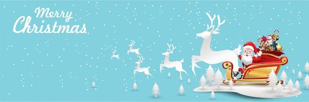 Joyeux noel et bonne année. le père noël monte concept d'art de papier traîneau renne