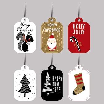 Joyeux noël cadeaux tags pour vecteur de vacances d'hiver