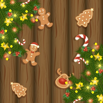Joyeux noël carte avec des biscuits au gingembre sucrés sur bois