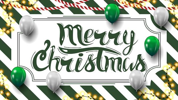 Joyeux noël, carte postale avec texture rayée verte et blanche sur le fond, guirlandes et ballons