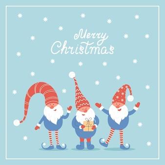 Joyeux noël carte postale trois gnomes mignons de noël de vecteur avec des bonnets rouges dans un style plat